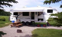 """2nd owners of this trailer, a nice clean unit owned by non-smokers and pet free. Dinette slide with hide a bed couch with air mattress. Rear kitchen with lots of counter space, larger oven with 3 burner stove, microwave etc. 32"""" LCD TV, 19"""" lcd in"""