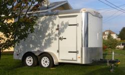 2011 Haulmark cargo trailer; 12.5'L x 6'W x 6.5'H; tandem with torsion suspension; spare tire; rear barn doors w/side man door; 2 interior lights; tows up to 7000 lbs.; used once from AB to Cape Breton. Asking $5500 obo. Can be viewed in Louisdale. Call