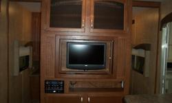 32 FT, SLIDES, BUNKS, OUTSIDE KITCHEN, FULL BEDROOM AT FRONT. TV/DVD, UVW:8490 POUNDS, GVW;9950 POUNDS. AS LOW AS $199/MO. FINANCING AVAILABLE @ 6.39%.