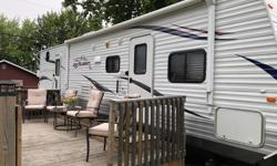 We have purchased a cottage therefore we are selling our travel trailer. We are 2nd owners the first owners were good friends of ours and we bought the trailer from them when they bought a cottage. Trailer is on a seasonal lot on Charleston lake complete