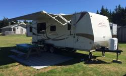 This is the 24' model with rear King size bed slide (length reaching almost 30' when open), in addition, this model has a 46'' double and 40'' single bunks. Fold down dinette and a sofa bed are contributing to the bed space of up to 7 persons. This is