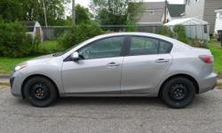 Make Mazda Model Mazda3 Year 2011 Colour Liquid Silver Metallic kms 34000 Trans Automatic Selling Certified!! $9200 or best offer Liquid Silver Metallic exterior Black interior Air conditioning Cruise control Power windows Power mirrors Power door locks