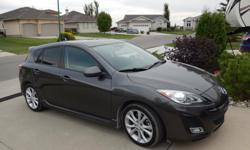 Make Mazda Model Mazda3 Sport Year 2011 Colour grey kms 64000 Trans Automatic 2.5L, 5 speed automatic, heated leather seats, power sun roof, dual climate control, power seat, auto leveling Bi-Xenon headlights, LED tail lights, 2way remote start, 18 inch