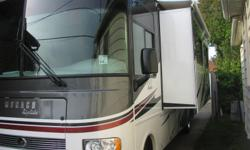 2011 Monaco Riptide, 31 feet long, brand new condition, this motor home is loaded, Ford V10, 1 slide, Full Bath, Queen bed in rear, Queen sofa pull out, day and night shades, air conditioning, 5.5 Onan Generator, 50 Amp, Tire simulaters, Microwave with