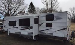 For sale is a 30 foot 2011 Puma Travel Trailer. We are the orignal owners. We are buying a bigger trailer and that is the reason for selling. The trailer is in excellent condition. Below is a list of options: - Outdoor Kitchen with Microwave, Fridge, sink