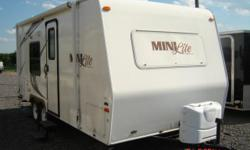 2011 Rockwood Mini Lite Trailer for sale by sole owner 5 year old, 21' trailer for sale - 2011 Rockwood Mini Lite travel trailer, Model M2104. Sleeps 4 comfortably. Lightly used. Pet / smoke / kid free. Some additional features include: Patio awning; roof