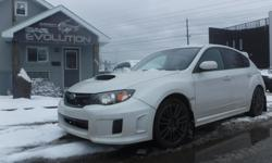 Make Subaru Model WRX STi Year 2011 Colour WHITE kms 154000 Trans Manual 6 MONTHS WARRANTY WITH PURCHASE FOR FREE ! 2011 SUBARU IMPREZA WRX STi (AWD) ALL WHEEL DRIVE MUST BEAT THE WINTER, POWERFUL 4 CYLINDER 2.5L ENGINE EASY ON GAS !! LOADED WITH 6SP