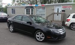 Make Ford Model Fusion Year 2012 Colour black kms 128521 Trans Automatic Extra clean car: well equipped with power windows and locks, AC, cruise control, power mirros, mag wheels with great tires, 4 cylinder FWD. Safety and etest included! SIMPLE PRICING