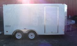 """2012 Haulmark 7'x14'   White,15"""" radials,rear ramp door,tandem 3500lb axles,18"""" v nose,white spoke wheels,3/4 inch plywood decking,2ea 12 volt dome lights,3/8 plywood sidewall,1pc aluminum roof,24 in stoneguard, 32""""x72"""" man door. For more information call"""