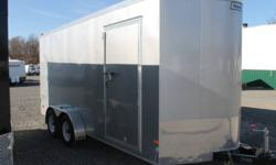 """SILVER EXTERIOR COLOUR, REAR BARN DOORS, SIDE ENTRY DOOR, FRONT STONEGUARD, 2 X 12V INTERIOR DOME LIGHTS, 12V SURFACE MOUNT WALL SWITCH, 6"""" ADDITIONAL HEIGHT, ELECTRIC BRAKES, 4 X SQUARE D-RINGS, GVWR 7000LBS, DRY WEIGHT 2275 LBS www.1000islandsrv.com"""