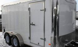 """WHITE EXTERIOR COLOUR, REAR BARN DOORS, SIDE ENTRY DOOR, 6"""" ADDITIONAL HEIGHT, FRONT STONEGUARD, 2 X 12V INTERIOR DOME LIGHTS, 14"""" X 14"""" NON POWERED ROOF VENT, CHROME FRONT CORNERS, 12V SURFACE MOUNT WALL SWITCH, 4 X SQUARE D-RINGS, GVWR 7000LBS, DRY"""