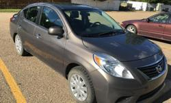 Make Nissan Model Versa Colour Brown Trans Automatic kms 131000 Very clean $5500 OBO Nissan versa 6.5 litres / 100 kms Car is in a very good condition Women driven Never smoked in Power windows Power mirrors Brand new winter tires with rim And a set of