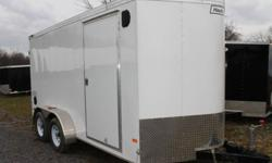 BUILT BY HAULMARK, WHITE EXTERIOR COLOUR, REAR BARN DOORS, SIDE ENTRY DOOR, FRONT STONEGUARD, 2 X 12V INTERIOR DOME LIGHTS, 12V SURFACE MOUNT WALL SWITCH, 8 X SQUARE D-RINGS, GVWR 7000LBS, DRY WEIGHT 2125 LBS www.1000islandsrv.com