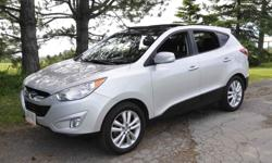 Make Hyundai Model Tucson Year 2012 Colour Silver kms 122500 2012 Tucson Limited 2.4L AWD loaded. 122,500 km. Touch screen navigation with backup camera and voice commands, Bluetooth, 18 inch Alloy wheels, heated leather front seats, panoramic sunroof,