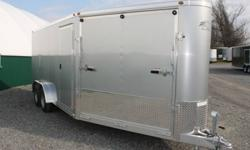 SILVER EXTERIOR COLOUR, REAR RAMP DOOR, SIDE ENTRY DOOR, FRONT RAMP DOOR, FRONT STONEGUARD, ROOF VENT, DOME LIGHT WITH WALL SWITCH, WIRE GROMMETS, ALUMINUM FRAME, ELECTRIC BRAKES, ONE PIECE ALUMINUM ROOF, 7X20, GVWR 7700LBS, DRY WEIGHT 2410LBS ALL