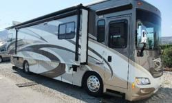 ABSOLUTELY BEAUTIFUL and LOADED! Includes a power-awning (w/wind sensor) and door awning, front and rear air suspension, automatic hydraulic leveling jacks, 10,000lb trailer hitch, power captains seats, RV Radio/Rearview Monitor System, MCD American Duo