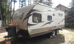 2014 Wildwood 18 ft X-lite travel trailer. $3000 worth of extras including solar. Double bed with single bunk above.