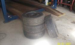 Four studded winter tires on rims. 205 60 R16.Came of a '07 Pont. G6..