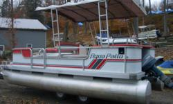 1990 Aqua Patio pontoon boat, with 30 hp Yamaha. Nice riding comfortable boat;canopy, ladder, jackets, swimdeck on front, sundeck on the back, good on gas. Built in gas tank. Furniture has usual wear. Have a new captain seat not shown in pics. Floor and