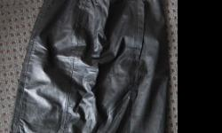 Genuine Leather Lined for comfort,, zippered back with snap. Back split,length just above knee. size 9 (states size 15, mislabelled) fits a size 9/10. Pick-up ONLY http://www.emporium85.com