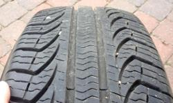 4 PIRELLI All-Season Tires Used one summer (9619 km) All 4 for $200.00