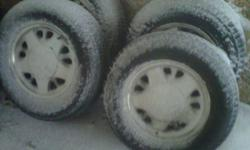 two snow tires, and two all season tires, size 215/75/15, tires have lots of tread snow tires have some weather cracks but dont leak, they are  mounted on 5 bolt chevy aluminum rims with center caps. great for the winter or spares, asking $100 FIRM
