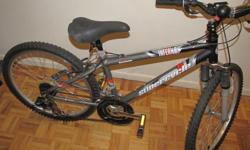 CANADIAN made 21 speed Inferno Supercycle 6061, ultra light ,partial suspension and come with a handle gear..Almost new and in mint condition for sale.