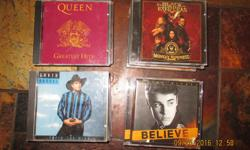 22 Assorted CDs, of various genres Including:: Garth Brooks Reba Justin Beiber Matchbox Twenty Black Eyed Peas Destiny's Child George Michael and many more all in original cases Will meet anywhere in west end (Kanata, Bells Corners, Barrhaven)