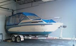 New canopy ($2500.00) Tandem trailer included ($1200.00) Runs good Needs tune up and battery. Stored indoors for the last 3 years Must sell- no time or room to keep Have additional identical boat for sale on single axel trailer also for sale.