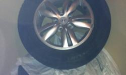 Used only for a couple months. 4 Alloy rims included with hyundai logo. Like new 4 Michelin x-ice tires. This ad was posted with the Kijiji Classifieds app.