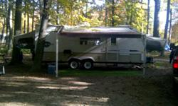 23ft Travelstar hybrid trailer in excellent condition. Three (3) tip-out queen-size beds. 1 slideout, 3-way firdge/freezer, gas oven/stove, built-in microwave. Three (3) pcs bathroom. Table/bench seats 4 comfortably whichs lowers to another bed. A/C and