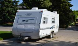 This is a clean 23' camper the can easily be pulled with a 1/2 ton truck.   Sleeping arrangements are 1 queen size bed in the front, the table folds down to create another bed and the cupboard above the queen bed folds out to create a third bed.   Camper