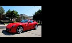 CALIBER AUTO LTD. IS EXTREMELY EXCITED TO OFFER FOR SALE THIS BEAUTIFUL FERRARI 599 GTB FIORANO PRESENTED IN RED WITH A BLACK INTERIOR - THIS IS AN ORIGINAL CAR - NO ACCIDENTS OR PREVIOUS DAMAGE - BOTH CARPROOF AND CARFAX VERIFIED - THIS CAR IS EQUIPPED