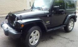 2010 Jeep Wrangler Sahara, powered by a 3.8L V6. This 6 speed manual transmission, 2 door, black SUV has 43,000 kms on it and features a grey interior. This Jeep is still under full warranty (until 5 years or 100,000kms).This Wrangler comes with: Dual