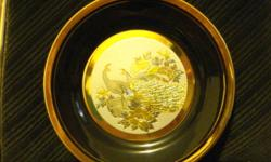 I have a very beautiful 24k gold gilded collectors plate. The pattern is 2 peacocks. I am asking $20 or best offer. This would make an excellent holiday gift. Email if interested. Thanks