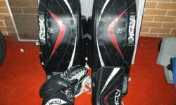 "I am selling my hockey equipment due to the fact that I will be moving up a pad size. I previously bought this hockey equipment used and have had it for two seasons.Included are:RBK SR 6K 32"" Black/Red Goalie PadsRBK JR 6K Matching BlockerRBK JR 6K"