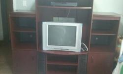 Dark cherry finish, currently holding a 32 inch tv (can be included at no extra charge). Lots of storage for cd's, dvd's, all tv accessories and video games. Very sturdy. Does not include cable box. Pick up only. Lower shelves have solid doors (perfect
