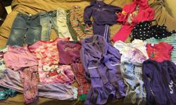 2 swim suits, 4 sets of pj's, a robe, 2 pair jeans, 1 yoga pant, 2 leggings, 4 short sleeve and 4 long sleeve shirts. Used but lots of life to go. Check out my other listings for more items!