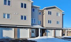 # Bath 2.5 MLS 985370 # Bed 2 THIS IS A 10! Practically new gorgeous 3 level town home in a great location. Beautiful hardwood through main level and second level while 3rd level has carpet from wall to wall & ceramic tiles. Eat-in kitchen w/ stainless