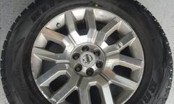 4 winter Bridgestone Blizzak tires 265/60 R18 with genuine Nissan Frontier factory rims (rims have beginnings of surface corrosion as seen in picture, does not affect the use of the tire). Tires used for 1 1/2 seasons, lots of tread left. Same tires new