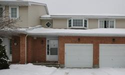 # Bath 2.5 MLS 985011 # Bed 3 Move in ready! This is a must see, great 3 bedroom town home with fully finished lower level with gas fireplace. Beautiful hardwood throughout main level & 2nd level and eat-in kitchen w/lots of cabinet space. Large master