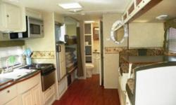 Like New.  29 foot Maxlite Trailer.  Beautiful Modern Interior.  Amentities: Air Conditioning Awning Microwave Stove/oven Bath tub/shower Queen bed, bunk beds, sofa and table (both convert to beds).  Sleeps 6 to 8 comfortably.
