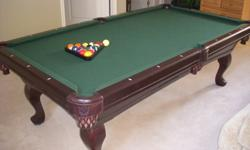 "4 X 8 ""Connelly"" Solid Oak Pool Table on a 1 inch slate bed. This pool table cost over $4,000 brand new. Comes with Balls, Cues, and Cue Rack.Excellent condition."