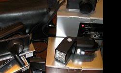LEICA X1 WITH FLASH, AND ALL ACCESSORIES..