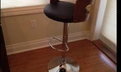 Black upholstered, wooden back, bar stools. New condition. Easy to adjust to any height. Revolve on stand. Comfortable and attractive.