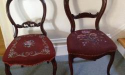 2 antique Victorian parlor chairs These two charming antique Victorian balloon back, needlepoint chairs have been owned by my 99 year old mother for years. The chairs are solid wood, sturdy, with little wear-and-tear. The needlepoint seats are in great