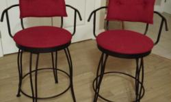 Red, wrought iron, swivel stools. Almost new and very comfortable. See Creative Home Furnishings website for description.