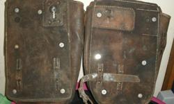 2 leather bags for 'hanging' at each side of a bike, hardware included. $ 50.-- obo