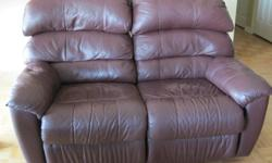 """2 """"ELRAN"""" leather love seat with both seats fully reclinable (3 inches from wall) $450 each Finished backings Color: Burgundy Size: 58 inches wide by 36 inches deep No holes, no tearing Check out my other ads. Phone Anne 613-604-2607"""