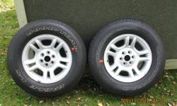 2 unused Goodyear Eagle LS all season tires that came with early 2000 Dodge Dakota trucks. Tires are new take-offs with zero miles.(rims shown with tires have been sold).